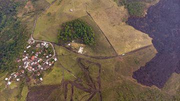 Lava gushes down the slopes of Pacaya Volcano near El Patrocinio village in San Vicente Pacaya.
