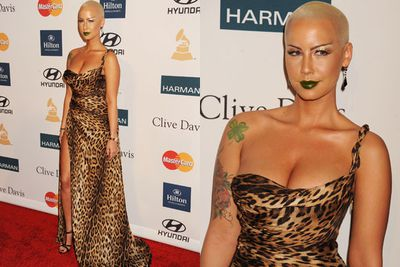 While Amber Rose seemed happy to be at the 2012 Grammys, her angry eyebrows looked like they would rather be anywhere else. <br/><br/>Perhaps because they were paired with tacky animal-print and an emerald-green lip?