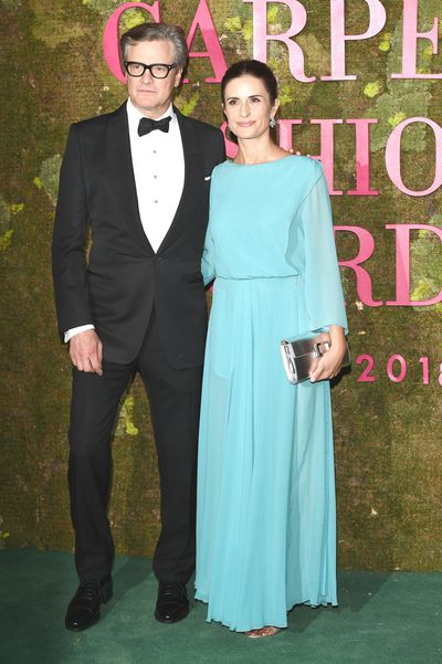 Colin Firth with wife Livia Firth. Livia wears a gown by family-owned Italian fashion house Laura Biagiotti.