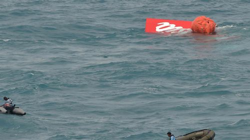 Tail of crashed AirAsia jet lifted from seabed without black box recorders