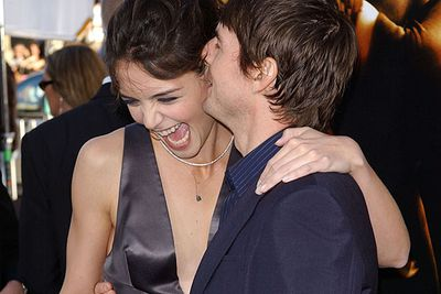 Pictured not long after they first hooked up in 2005: For the first few months of their relationship, Tom always seemed to be whispering something hilarious in Katie's ear.