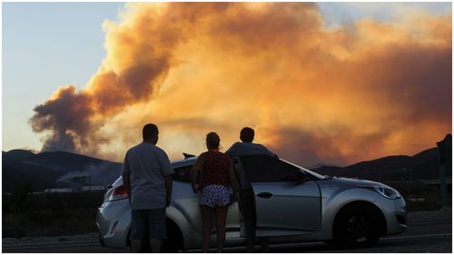 Hundreds of homes and buildings destroyed as wild fires continue to burn through California