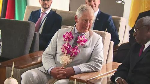 Prince Charles met with the President of Vanuatu and was presented with a garland of flowers upon his arrival. Picture: 9NEWS.