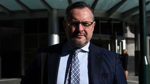 Queensland lawyer Adam Magill will stay in jail for allegedly breaching his bail conditions by contacting a lawyer in a corruption case against him.
