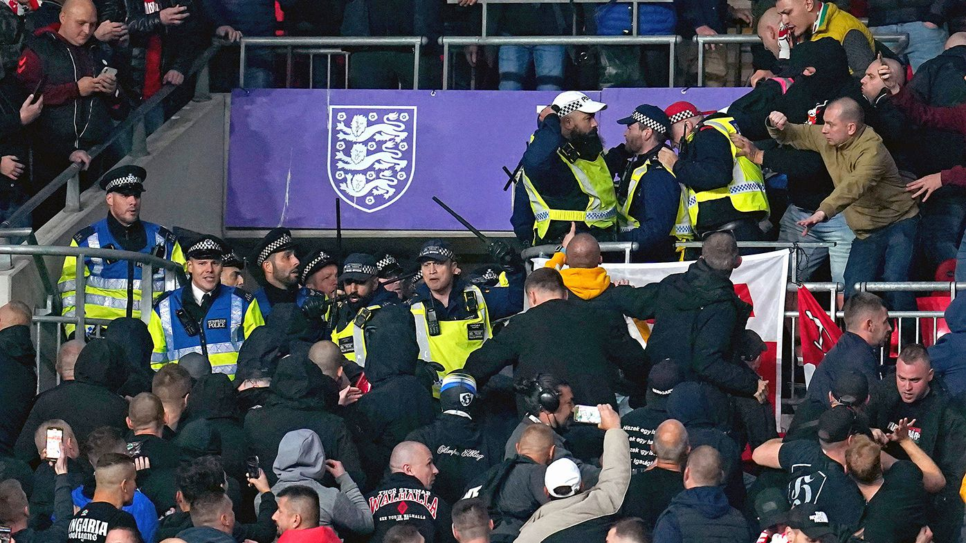 Police called to deal with fans as ugly scenes mar World Cup qualifier at Wembley Stadium