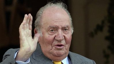 Spain's former monarch King Juan Carlos waves upon his arrival to the Academia Diplomatica de Chile in 2018.