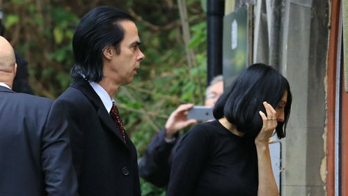 Musician Nick Cave with his wife Susie Bick arrive at the Coroners Court in Brighton. (AAP)