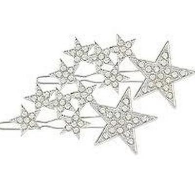"""<em><a href=""""http://www.ulta.com/silver-star-hair-clips-w-rhinestones?productId=xlsImpprod16621240&sku=2512340&irgwc=1&AID=313779&PID=57486&CID=af_313779_57486_"""" target=""""_blank"""" draggable=""""false"""">Scunchi Silver Star Hair Clips w/ Rhinestones, $12.99 </a></em>"""