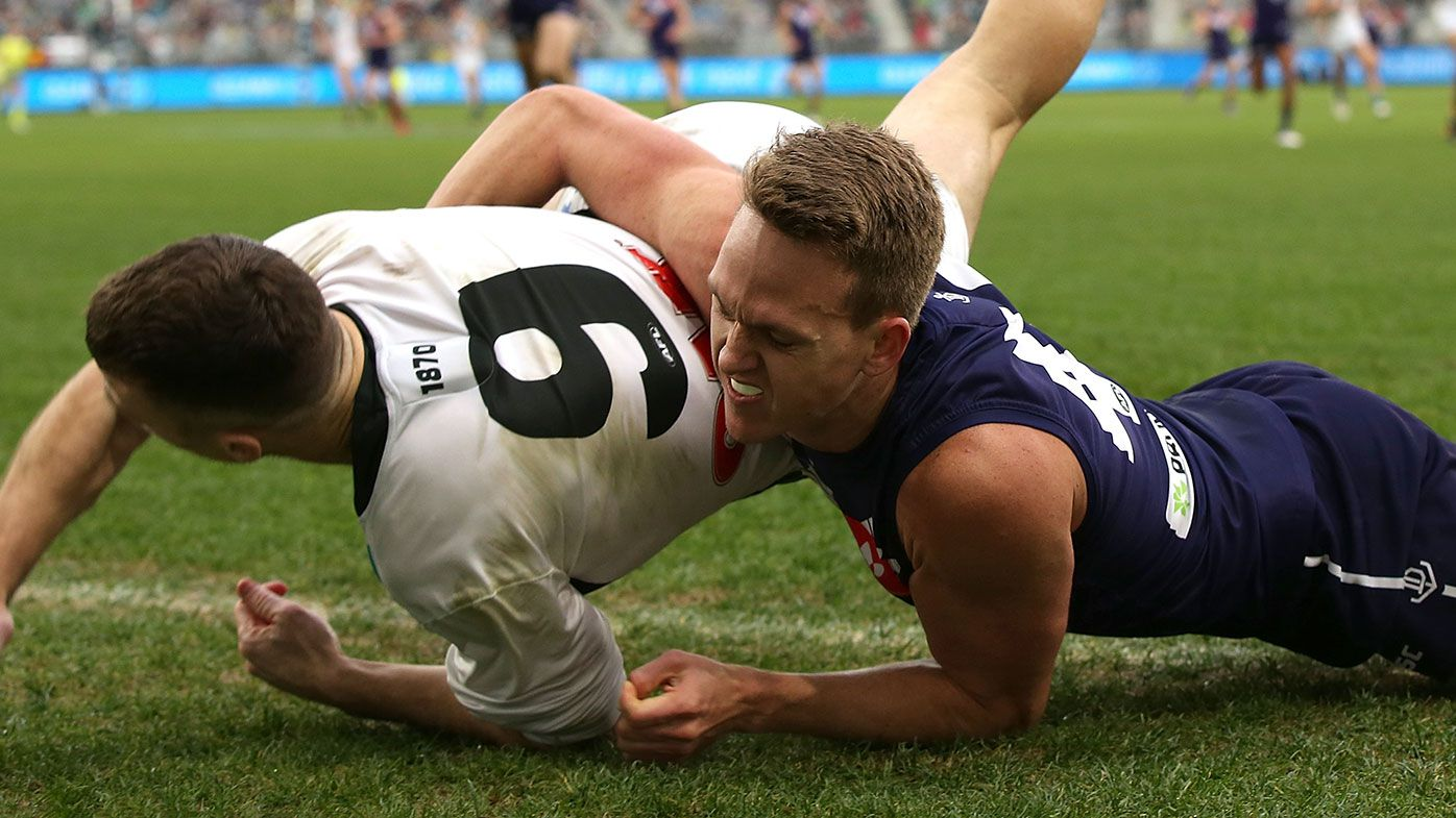 Ryan Nyhuis of the Dockers tackles Robbie Gray of the Power.