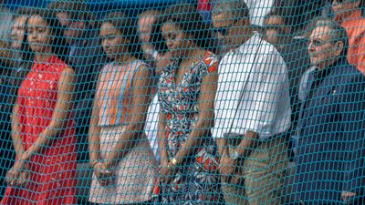 """<p>US President Barack Obama, first lady Michelle and daughters Sasha and Malia stand with Cuba's President Raul Castro during a moment of silence for the Brussels attacks victims at a baseball game in Havana.</p><p><a href=""""http://www.9news.com.au/world/2016/03/22/22/54/world-leaders-react-to-brussels-terror-attacks"""">World leaders have paid tribute</a> to the victims and reacted to the deadly bombings. (AFP)</p>"""