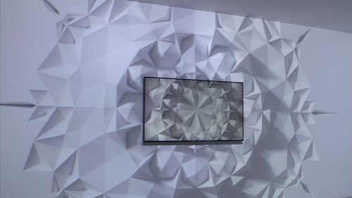 "Samsung has introduced ""ambient mode"" which allows a TV to ""blend"" into the wall. (9NEWS)"