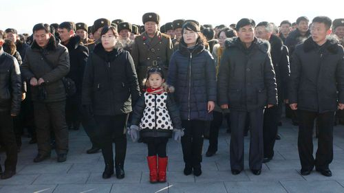 People visit Mansu Hill to pay respect to the statues of their late leaders Kim Il Sung and Kim Jong Il at Mansu Hill, marking the sixth anniversary of leader Kim Jong Il's death in Pyongyang. (AP)