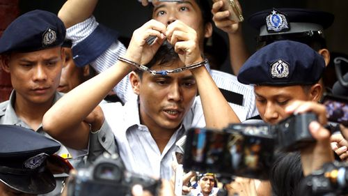 Reuters journalist Kyaw Soe Oo is escorted out of the Insein township court in Yangon, Myanmar. Insein township court sentenced both Wa Lone and Kyaw Soe Oo to seven years prison after they were found guilty of violating a state secrets act while working on a story. (AAP)