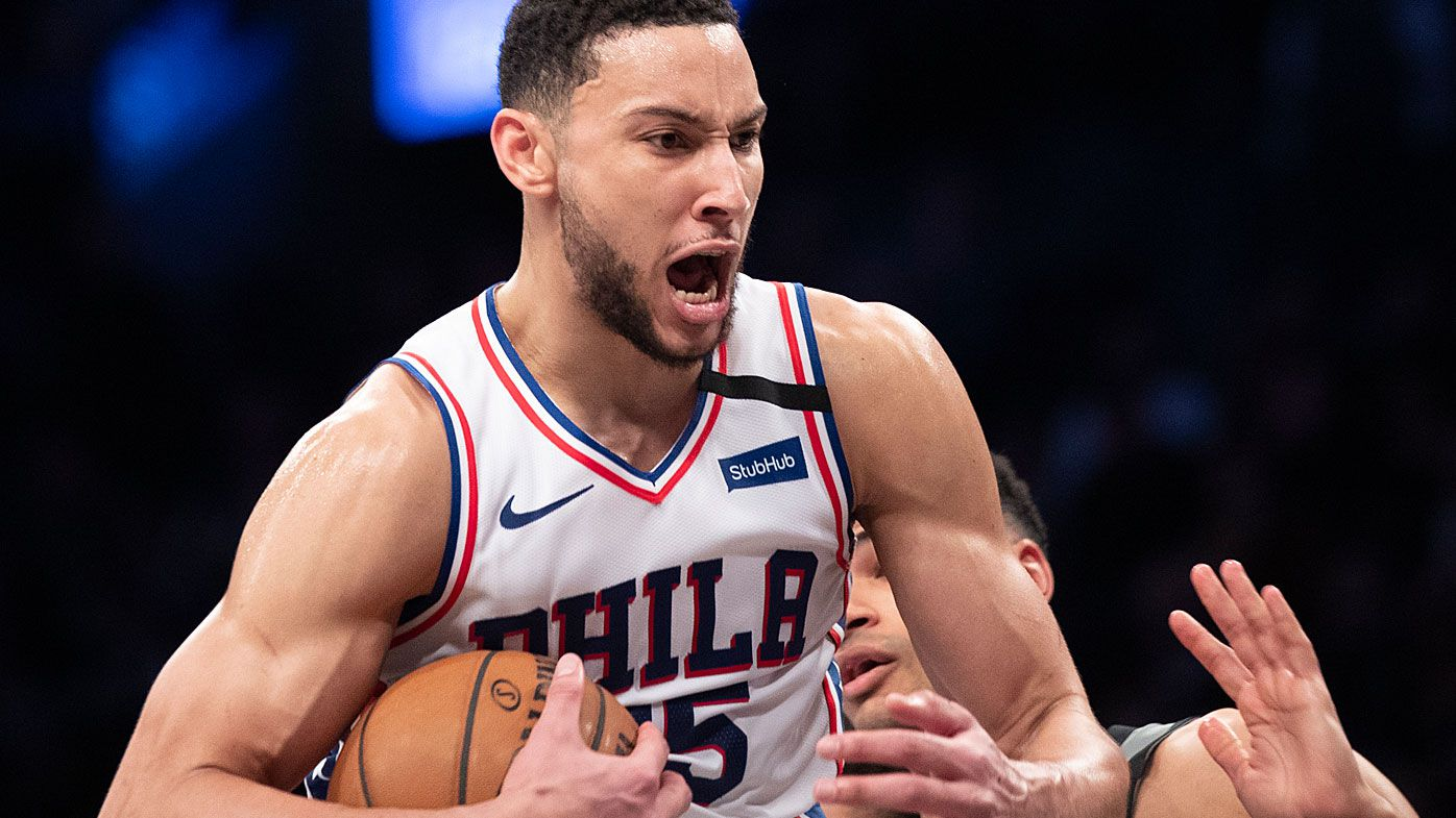 Philadelphia 76ers guard Ben Simmons reacts after grabbing a rebound during the second half of an NBA game against the Brooklyn Nets