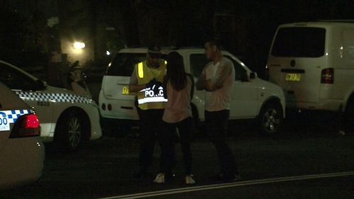 The man was initially trapped under the car. (9NEWS)