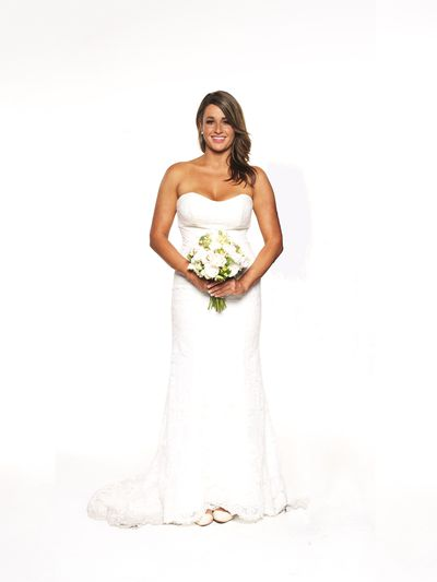 "This <a href=""http://dressense.com.au/product/allure-bridals-2903/"" target=""_blank"">Allure gown</a> featured a strapless fitted bodice in creamy white which showed off Lauren Bran's beautiful tanned figure. Sweet ballet flats completed her look. Might they be good for running in?"