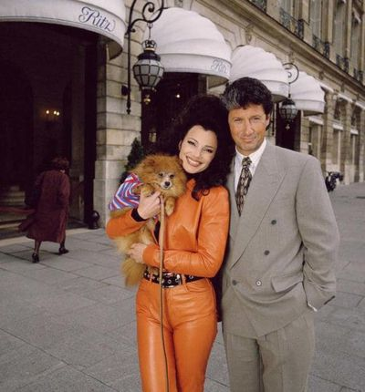 The Nanny's Fran Fine in an orange leather suit and Chanel belt with TV husband Maxwell Sheffield