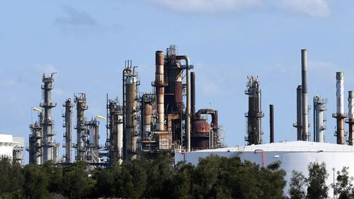 Refineries in Brisbane and Geelong are being offered an extra incentive to stay in Australia.
