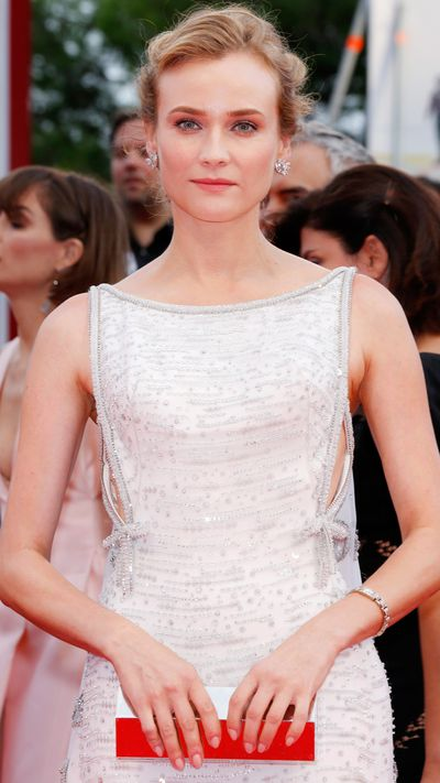 Diane Kruger wears earrings by Kwiat and a watch by Jaeger-LeCoultre at the opening ceremony.