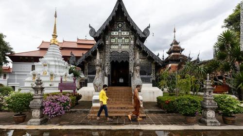 A monk walked through a near empty Wat Chedi Luang in Chiang Mai, Thailand.