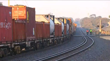 A car was pushed onto train tracks by another car this morning, causing it to be hit by an approaching train.