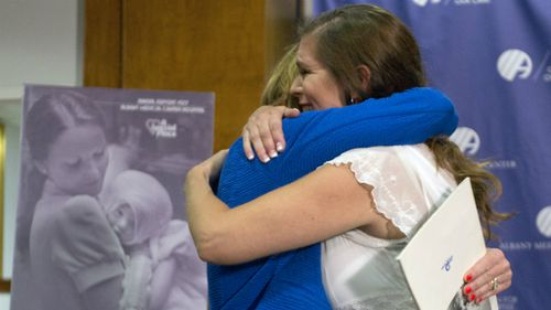 The pair's emotional reunion was arranged after a Facebook plea went viral. (AAP)