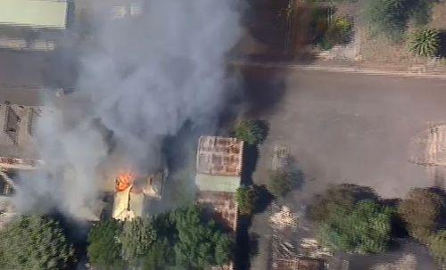 Fire crews are battling the massive blaze. (9NEWS)