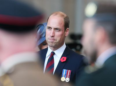 Prince William listens to speeches during the ceremony.