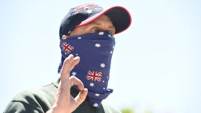 Many protesters from both sides concealed their faces with material, many from Reclaim Australia using fabric covered in the Australian flag. (AAP)