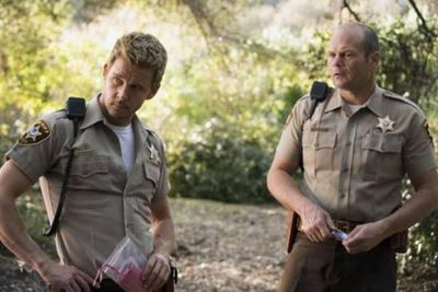 Buff cop Ryan Kwanten as Jason Stackhouse and Chris Bauer as Andy Bellefleur in the HBO series. <br/>