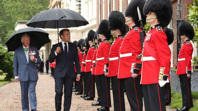 Prince Charles, Prince of Wales and French President Emmanuel Macron inspect the Grenadier Guards at Clarence House on June 18, 2020 in London, England.