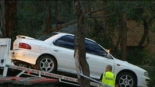 Police take the car for forensic testing in 2013. (9NEWS)
