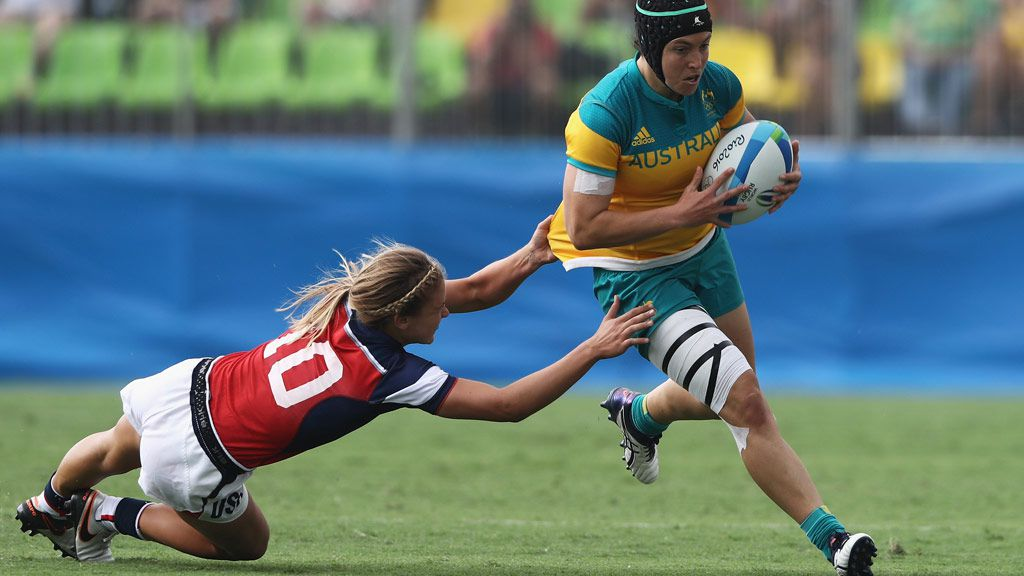 Sharni Williams carries the ball under pressure against Richelle Stephens of the United States (Getty)