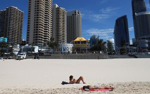 Man charged after 21-year-old falls from Surfers Paradise balcony