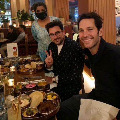 Paul Rudd posed for a photo with Dan Levy at an Indian restaurant in London called Darjeeling Express.