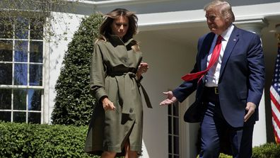 President Donald Trump and first lady Melania Trump arrive for a tree planting ceremony to celebrate Earth Day, on the South Lawn of the White House, Wednesday, April 22, 2020, in Washington