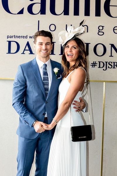 Matty J and partner Laura. Matty is dapper in blue while Laura is traditional in head to toe white accessorised with a bold black clutch and a gorgeous grin.