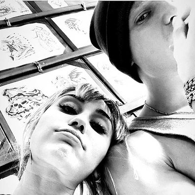 Cody Simpson and Miley Cyrus getting matching tattoos.