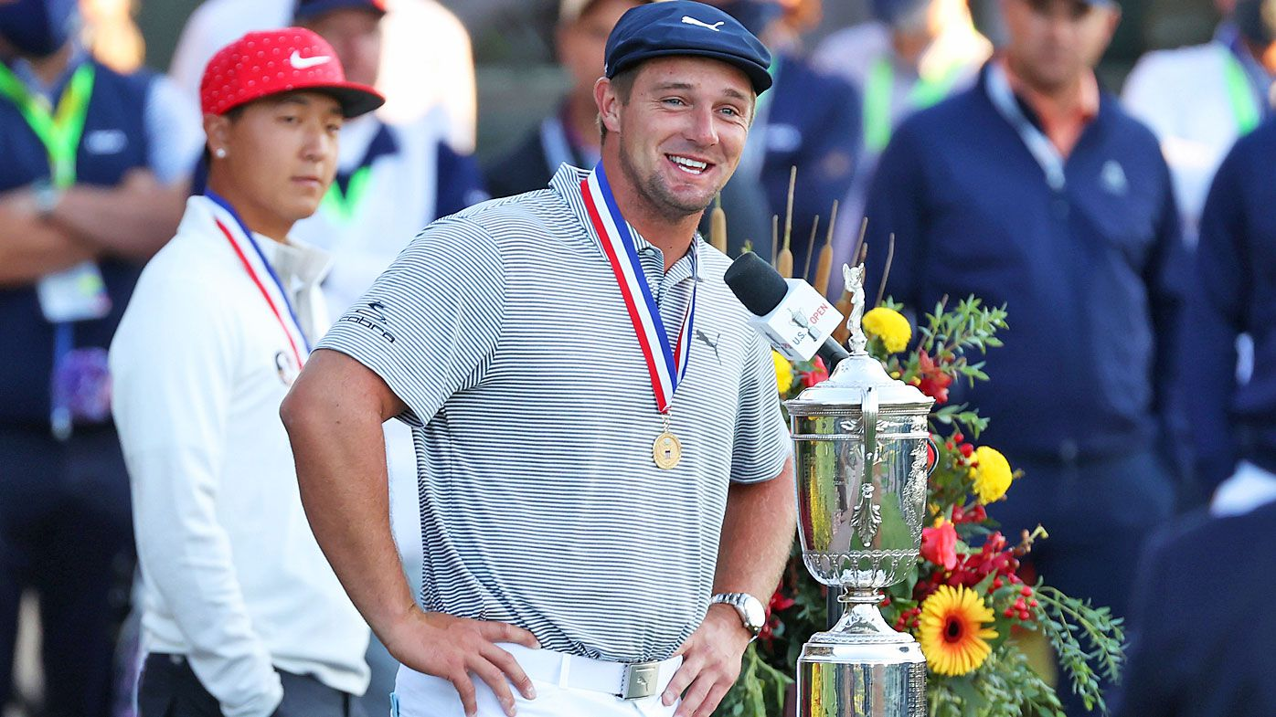 Champion Bryson DeChambeau of the United States speaks during the trophy ceremony