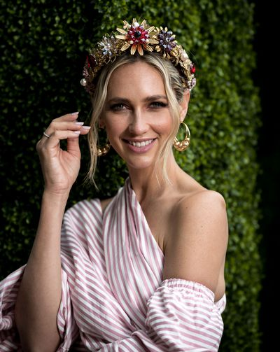 """<p>6) Bare shoulders</p> <p>The days of squeezing into a skintight dress and suffocating while sipping Champagne are over. Sun-kissed shoulders are as steamy as your racing attire should aspire too.</p> <p>Nikki Phillips in a Viktoria Novak crown and Asilio dress<br style=""""box-sizing: border-box;""""> </p>"""