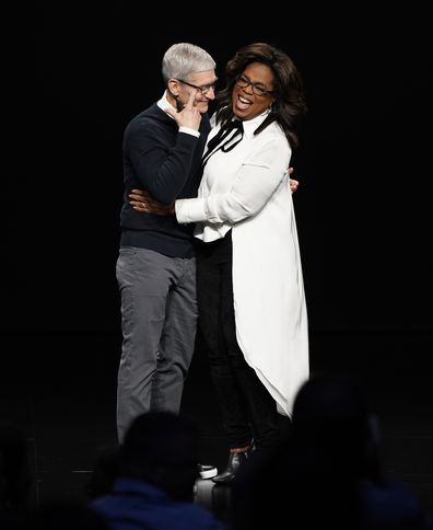 Tim Cook and Oprah Winfrey