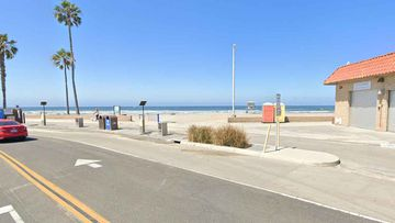 The woman was killed as she lay on the sand at Oceanside Harbor Beach.