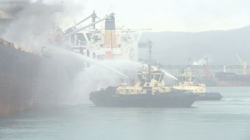 The blaze is expected to burn for the next three to four days on board a ship in Port Kembla.