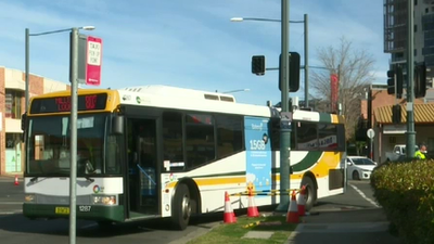 Woman hit by bus, another hit by garbage truck