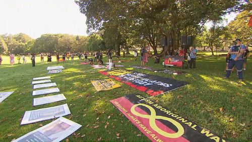 The first protesters have descended upon the Domain in Sydney