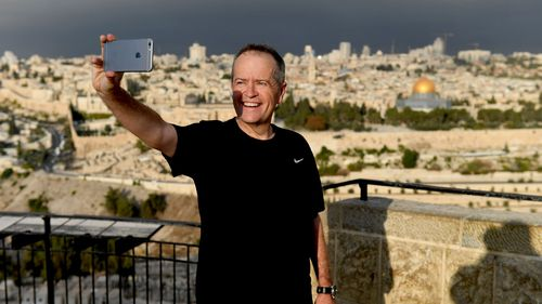Federal Labor leader Bill Shorten takes a selfie during his morning run at the top of the Mount of Olives in Jerusalem, Israel. (AAP)