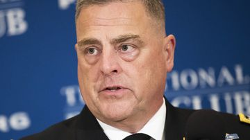 General Mark Milley, Chief of Staff of the U.S. Army, talks with an aide before speaking at the National Press Club, July 27, 2017 in Washington, DC.