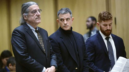 Fotis Dulos (centre) was accused of killing his estranged wife.