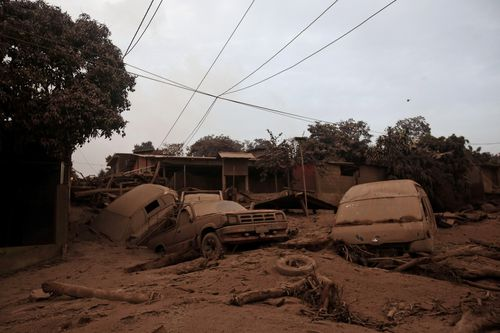 Cars covered by ash in  at the San Miguel Los Lotes hamlet, in Escuintla. Picture: AP
