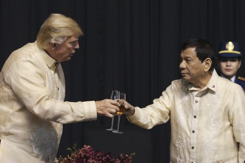 Donald Trump and Rodrigo Duterte at a gala dinner marking ASEAN's 50th anniversary. (AAP)